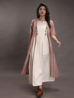 Off White Hand Embroidered Cotton Dress with Brown Striped Shrug- Set of Beautiful Dresses in different styles varying from Maxis to Shirt Dress & many more with the most attractive prints & colors. Kurta Designs Women, Kurti Neck Designs, Kurti Designs Party Wear, Blouse Designs, Casual Frocks, Casual Dresses, Fashion Dresses, Casual Cotton Dress, Suit Fashion