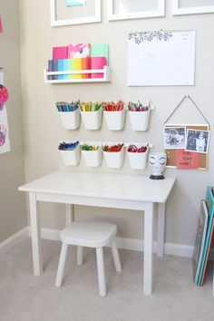 This playroom craft corner is so great! It's simple + functional + made for little crafters!