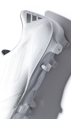Adidas football boot. White on white. Tonal