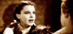 "THE WIZARD OF OZ (1939) ~ ""Oh, Auntie Em, there's no place like home."" ~ Dorothy (Judy Garland). [GIF]"