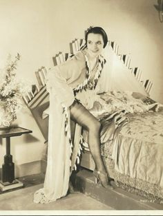 Louise Brooks getting in bed