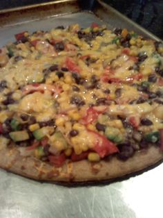 black bean pizza! one can black beans, 1 cup corn, 1/2 tomato diced, a few yellow cherry tomatoes, 1/2 cup diced onion, 1/2 avacado diced, salt and pepper mixed in bowl. shredded cheddar to help it stay together.