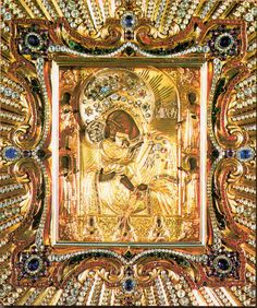 Close up Miracle Working Icon of Theotokos of Pochayiv, Ukraine: It was given by a wealthy widow Anna or Hanna Hoyska, who owned the town of Pochayiv in second half of the 16th century. Anna had received the sacred image from the Greek metropolitan Neophyte. In 1773, the pope Clement XIV, meeting the request of the count Nicolas Potocki sent two small golden crowns for the icon - one for the Holy Virgin, the other for Jesus. Thus the icon was acknowledged as wonder-making.