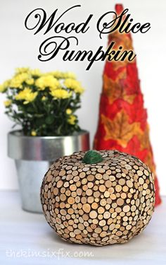 Rustic Wood Slice Pumpkin DIY. Transform an inexpensive dollar store pumpkin with wood slice vase filler from the craft store. From Kim Six Fix.