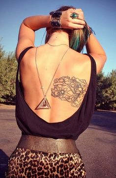 love the top with the scooped back, but love the tattoo!