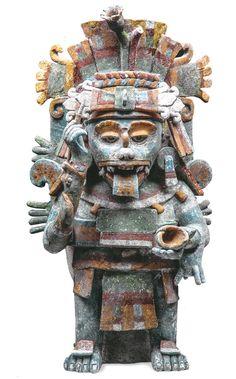 El escriba de los dioses Esta excepcional escultura del Posclásico (1250–1527) muestra a un hombre-mono aullador con un tocado de nenúfares y sosteniendo un cepillo y un bote de tinta. Para los mayas era el patrón de las artes y el intermediario entre los dioses y los humanos. Dominaba la escritura y era, por tanto, el guardián del conocimiento Foto: Museo Regional de Antropología, Palacio Cantón, Mérida, Yucatán, INAH / Martin-Gropius-Bau