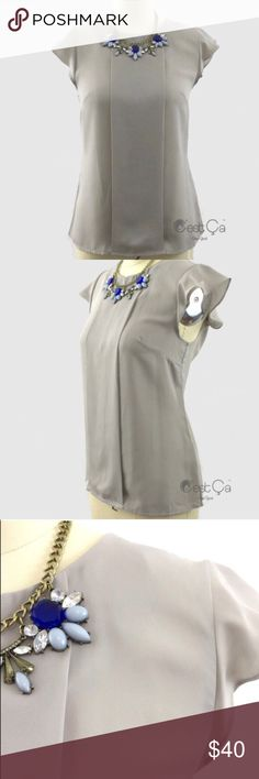 """Beautiful Gray Blouse Dove gray loose fit blouse with decorative front panel and frilled sleeves. Beautiful basic piece to pair with skirts or jeans. Crew neck, loose fit silhouette, buttoned neck line.                     Small (appx us 0/2) bust 33"""".                             Medium (appx US 4) bust 34.5.                         Large (appx US 6) bust 36"""".                            XLarge (appx US 8) bust 37.5 Cest Ca Tops Blouses"""
