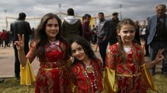 Children in traditional Kurdish clothing, pose for the photographer during the Newroz celebration, in Diyarbakir, southeastern Turkey, Tuesday, March 21, 2017. In Turkey, the spring festival traditionally serves as an occasion to demand more rights for the Kurdish minority. Photo: Lefteris Pitarakis.