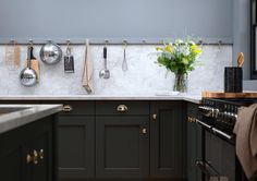 Black kitchen, worktop continued as splashback, peg rail - First Impressions Kitchens (@fikitchens) on Instagram
