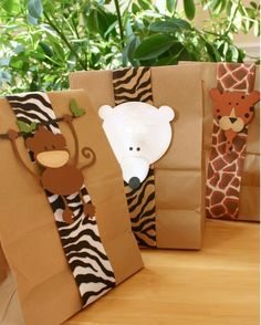 Put snacks in a paper bag, wrap with animal print ribbons, and stick an animal sticker on the front. Looks easy to replicate!