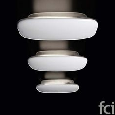 The Tivu Wall Sconce by Foscarini was designed by Jozeph Forakis in This contemporary wall sconce is made from a polycarbonate and is available in black or white finish. The Tivu looks great grouped together or alone. Italian Lighting, Modern Lighting, Low Ceiling Lighting, Ceiling Lamps, Modern Ceiling, Modern Light Fixtures, Home Decor Styles, Wall Sconces, Floor Lamp