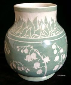 "cbacon-pottery: "" Lily of the Valley Vase Lily of the valley, also known as Convallaria majalis, have delicate tiny white bell-shaped flowers. They are a perennial favorite in bridal bouquets (Kate Middleton used them) and shade gardens, despite the. Pottery Plates, Slab Pottery, Ceramic Pottery, Pottery Art, Sgraffito, Ceramic Decor, Ceramic Design, Ceramic Vase, Cerámica Ideas"