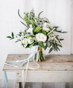 green bouquet on ivory reclaimed wood table, pantone coconut milk, ivory, off white