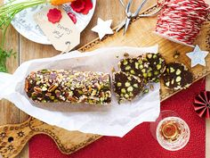 This beautiful dark chocolate, fig and pistachio nut salami is a brilliant sweet twist on the classic recipe. Serve your roll sliced at Christmas. Frozen Chocolate, Christmas Chocolate, Christmas Desserts, Chocolate Desserts, Christmas Recipes, Salami Recipes, Snack Recipes, Dessert Recipes, Snacks
