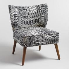 Our plush accent chair brings a boho vibe to any space with black and white tribal print jacquard upholstery and splayed wood legs.