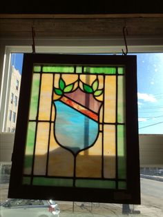 Antique stained glass shield window
