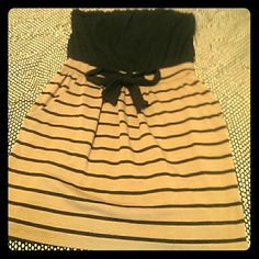 Strapless brown and black cotton dress Maude black top strapless brown and black stripped bottom with pockets and black accent bow at waist, super comfortable! Maude Dresses