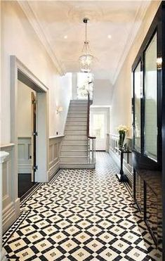 Perfect ceramic tiles for the floor in this grand, striking hallway. Love the gr… Perfect ceramic tiles for the floor in this grand, striking hallway. Love the grey panelled walls too. Hall Tiles, Tiled Hallway, Tile Entryway, Entry Tile, Long Hallway, Victorian Hallway Tiles, Edwardian Hallway, Victorian Stairs, Tiled Staircase