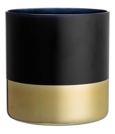 Black/gold-colored. Large color-block vase in painted glass with gold-colored lower section. Diameter 6 in., height 6 in.