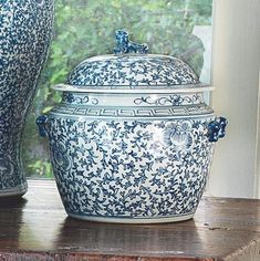 Twisted lotus pattern are painted from top to bottom, forming almost rope-like floral arrays around the surface of the vase. Vines find their way down the sides, randomly coming upon large twisted Lotus blossom designs, full of harmony and love. This high-fired porcelain Rice Jar is