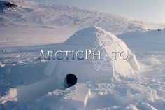 A traditional Igloo built with blocks of snow. Igloolik, Nunavut, Canada.: Canadian Eastern Arctic,: Arctic & Antarctic photographs, pictures & images from Bryan & Cherry Alexander Photography.