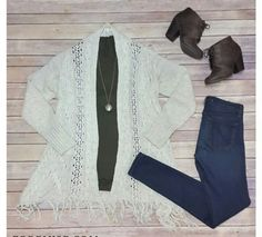 Olive shirt white sweater jeans and booties