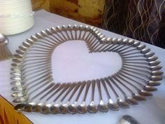 Creative cutlery arrangement for a party or buffet. Palm leaves are forks, knives form the trunk and overturned spoons give the illusion of.Top 7 Beautiful Arts Made With SpoonsSpoons on the dess Dinner Table, Dessert Table, Cutlery Art, Flatware, Dining Etiquette, Spoon Art, Napkin Folding, Table Arrangements, Event Decor