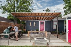 A Modern Backyard Trumps the Texas Heat New shaded areas offer a respite in an outdoor Houston living room, while a fire pit re-creates fond memories