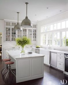 In decorator Victoria Hagan's Southport, Connecticut, residence, a spacious marble-clad island punctuates the kitchen.