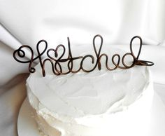 Rustic Wedding Cake Topper, Rustic Wedding Decor, Hitched Caketopper, 6 Inch. $35.00, via Etsy.