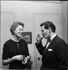 Leonard Bernstein [Leonard Bernstein talking to a woman at a party.]