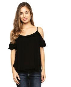 Blusa Anna FlynnBlusa color negro con crochet decorativo en parte frontal…