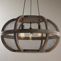 "Rustic Wooden Cage Chandelier Mesh wire wraps around distressed wood frames for an industrial style chandelier. This ceiling light is a perfect match over an antique farm table or in a farm house kitchen. The bronze finish accents stay true to the style of the light. Socket arms swivel slightly. Add Edison bulbs for a vintage look. Three 8' black pendant cords. Triangle-shaped pendant canopy measures 1.25""Hx10""W. (16.5""Hx27""W). 3x60 watts"