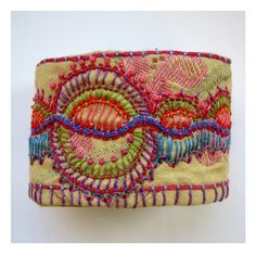 Madrigal Embroidery - fabric cuff made with decorator fabric & stitchery. Textile Jewelry, Fabric Jewelry, Textile Art, Embroidery Applique, Beaded Embroidery, Embroidery Stitches, Embroidered Bird, Textiles, Bordados E Cia