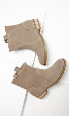 Soft suede taupe boots with a slouchy casual shape, pull tabs at the sides, rounded toe and stacked heel