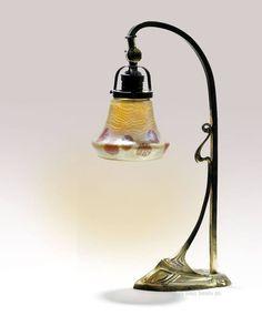 An Art Nouveau Loetz glass and brass table lamp circa 1910.