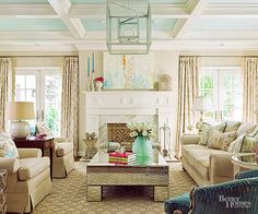 Much of what cements a living room as traditionally styled is its decorative features: molding, trim, woodwork. In this space, those elements bring solidity and elegance to the room, particularly the deep trim on the ceiling.