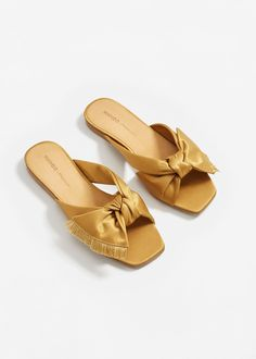 If there is one shoe style that is the most popular of summer it's satin bow slides. Zara, Forever and Mango have all made versions we love. Satin Shoes, Bow Shoes, Lacoste Shoes Women, Mule Plate, Mango Shoes, Bow Sandals, Fringe Sandals, Slide Sandals, Latest Shoe Trends