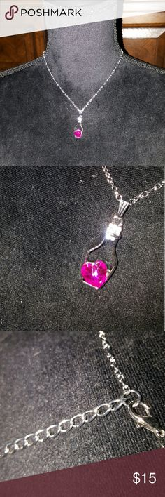 Pink Crystal Heart in a Bottle Necklace 20 inch silver tone chain with extender.   Silver tone chain. Pink Crystal glass heart in stainless steel heart. Small glass crystals adorn bottle neck for a little extra bling bling. Very cute. Makes a great gift for a loved one, none Jewelry Necklaces