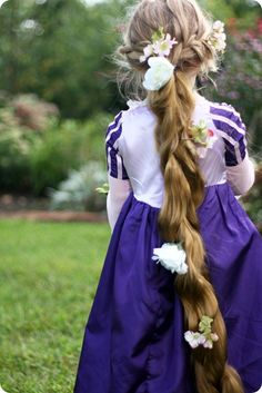 let's talk about rapunzel's crowning glory—her golden tresses. $4.99 at my local hair and wig store. i call that winning.  it's synthetic, so you can't do much with it in the way of styling. but it came out of the package already looking for all the world like rapunzel's braid. i just braided gigi's real hair to the back and attached this with a rubber band.