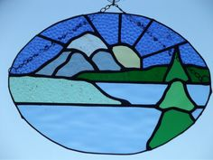 Mountain sunshine stained glass suncatcher by PerfectlyGlass