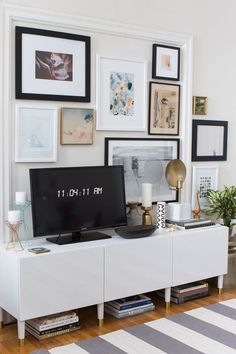 + living room // Filling up the space behind the tv with art