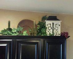 Tuscan decor... above cabinets #kitchendecoratingideasabovecabinets