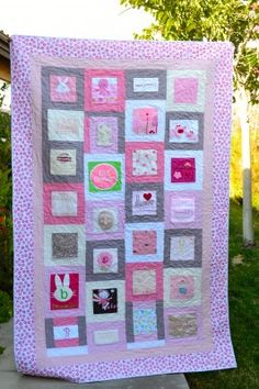 baby clothes quilt. Great way to keep a few of the cute onesies, I like how it has material around the onesie to make a block. Could also use favorite shirts, receiving blankets, burp rags, bibs, etc.