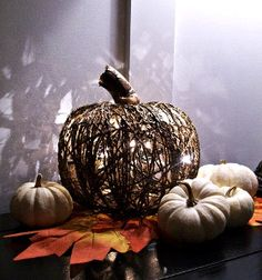 Twinkle and Twine Dollar Store Pumpkin | AllFreeHolidayCrafts.com