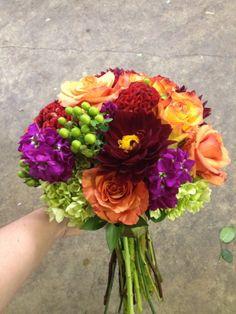 Bright bouquet including hydrangea, stock, roses, hypericum, dahlias and coxcomb.
