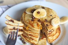 #paleo Banana Pancakes: 3 medium eggs, at room temperature; 1/4 cup non dairy milk (coconut or almond); 1 teaspoon vanilla; 1 teaspoon honey; 2 tablespoons coconut flour; 1/3 cup blanched almond flour (Honeyville or Digestive Wellness); 1/2 teaspoon baking soda; 1/4 teaspoon salt; 1 overly ripe banana; 1/4 cup chocolate chips, Enjoy Life; Butter or coconut oil for the pan