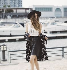 Get this look: http://lb.nu/look/7748164  More looks by Gabrielle L.: http://lb.nu/dentelleetfleurs  Items in this look:  Urban Outfitters Hat, Shop The 26 Look White Top, 424 Fifth B&W Coat, Vintage  Black Skirt, Free People Necklace   #bohemian #carefree #minimal