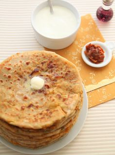 Aloo Paratha: Indian bread - stuffed with spicy, herbed potatoes and cooked on a tawa (griddle pan) . Cooking Bread, Cooking Recipes, Indian Food Recipes, Vegetarian Recipes, Punjabi Recipes, Indian Flat Bread, Punjabi Food, Paratha Recipes, Desi Food