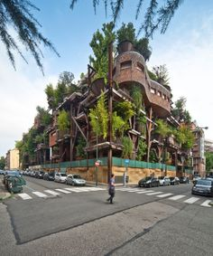 A vertical potted forest of trees and branching steel beams surround this apartment building in Turin, Italy.This Urban Treehouse is designed by Luciano Pia and the idea is that the urban forest installation absorbs the surrounding carbon dioxide that is a consistent problem in many large city's around the globe. This structure with over 150 trees can absorb almost 200.000 liters of carbon dioxide an hour and a great side affect it also blocks most of the noise pollution.